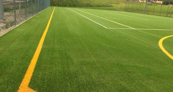 Tenna (TN) Realizzazione campo polivalente calcetto/tennis in erba sintetica